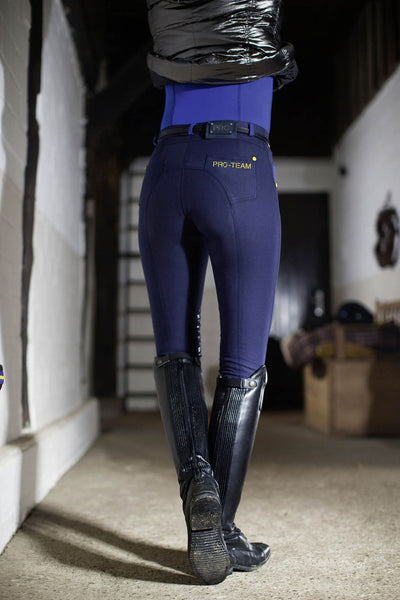 HKM Pro Team Flash Silicone Knee Patch Breeches in Corn Blue worn by Rider