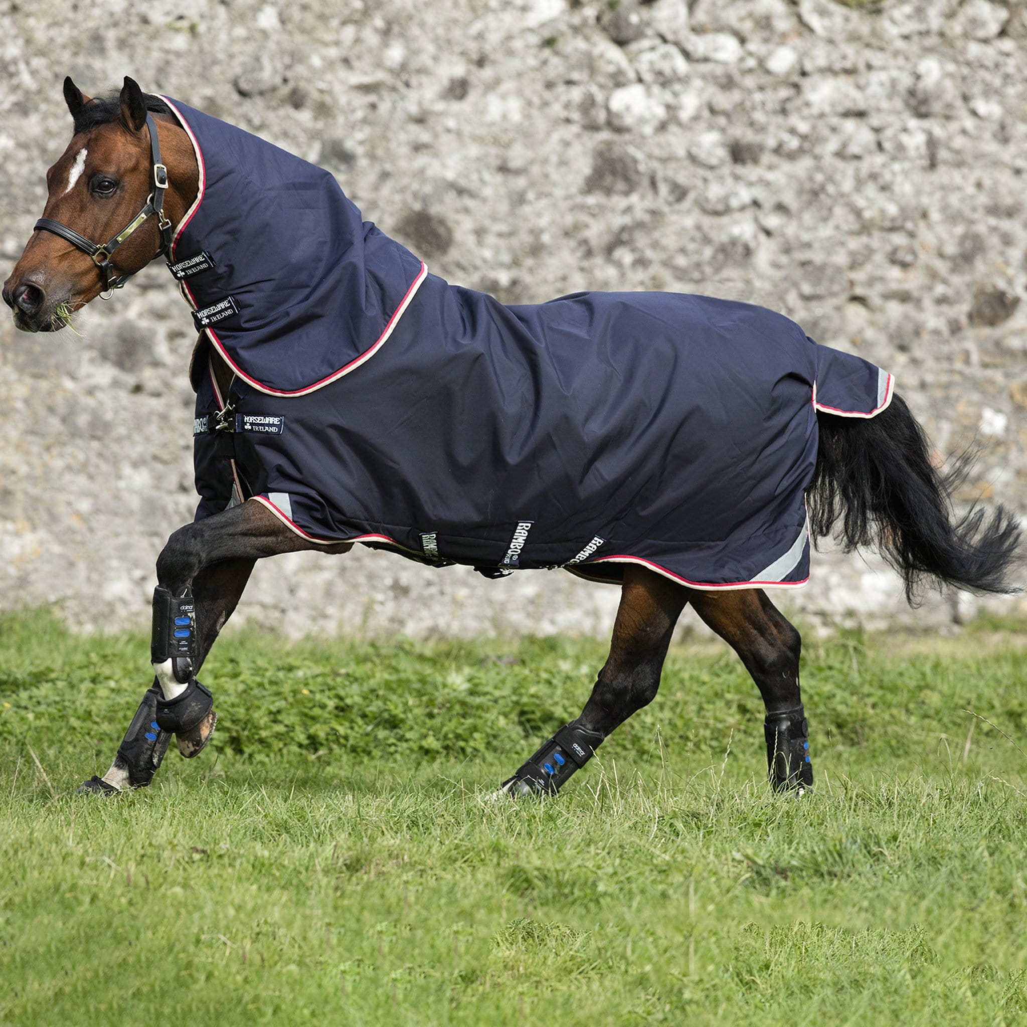 Rambo Bundle Duo Detachable Neck Turnout Rug AAAD84 On Bay Horse Cantering Side View.
