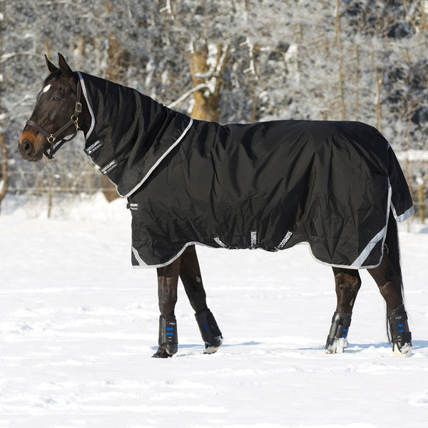 Horseware Rambo Supreme 250g Turnout Rug with Vari-Layer Side View in the Snow AAAX32