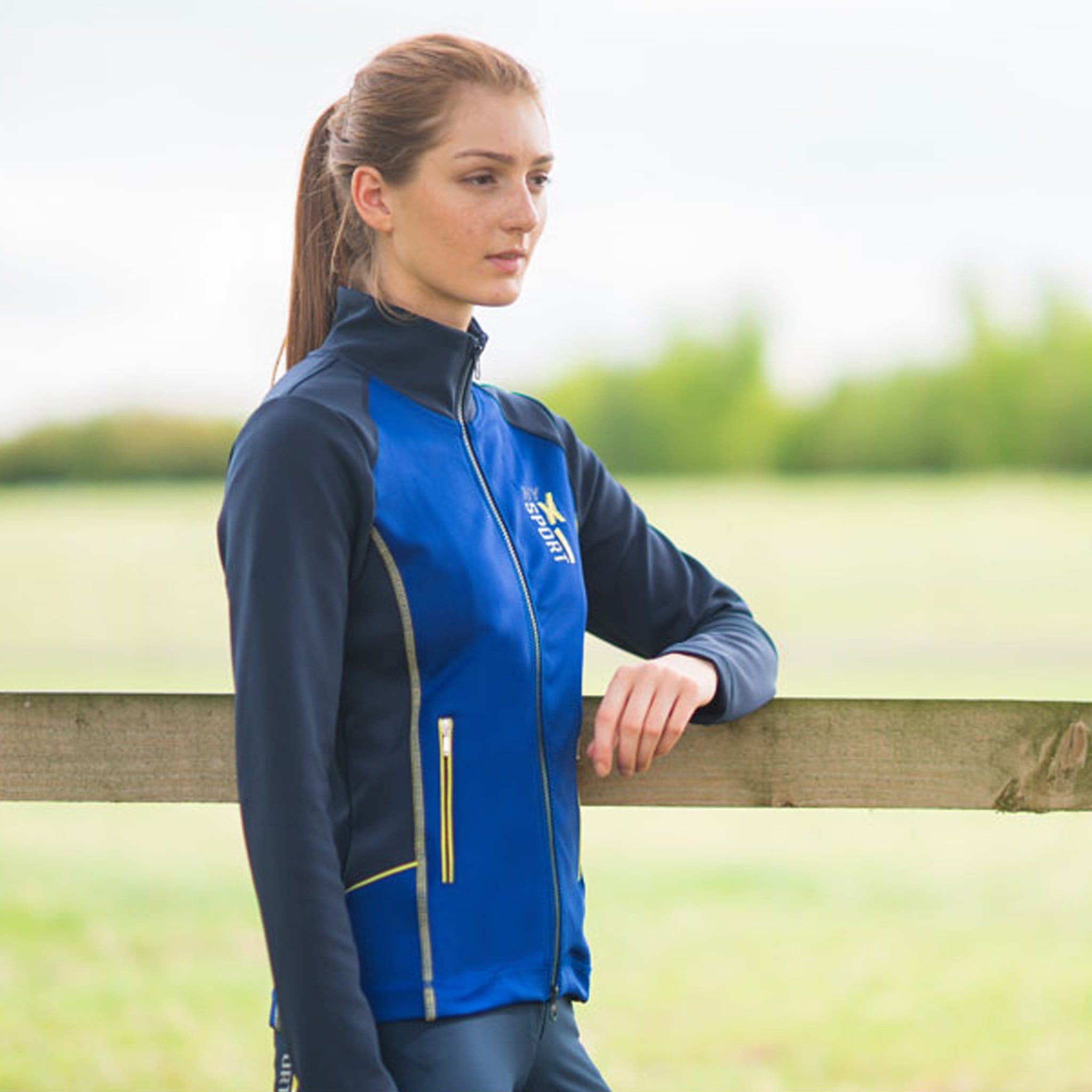 HyFASHION X Sports Jacket 22376 Side View On Model Leaning On Fence
