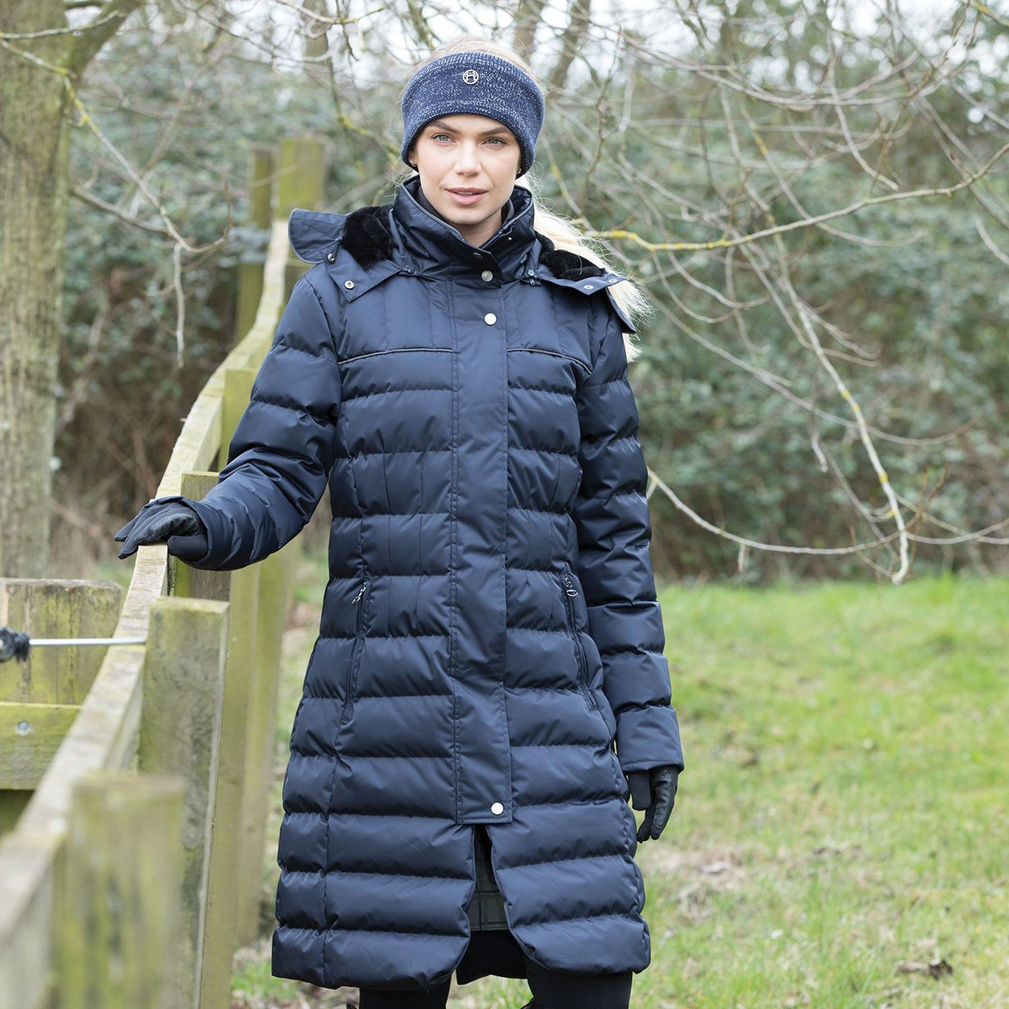 Equetech Alpha Long Padded Riding Coat APC Navy Front On Model By Fence