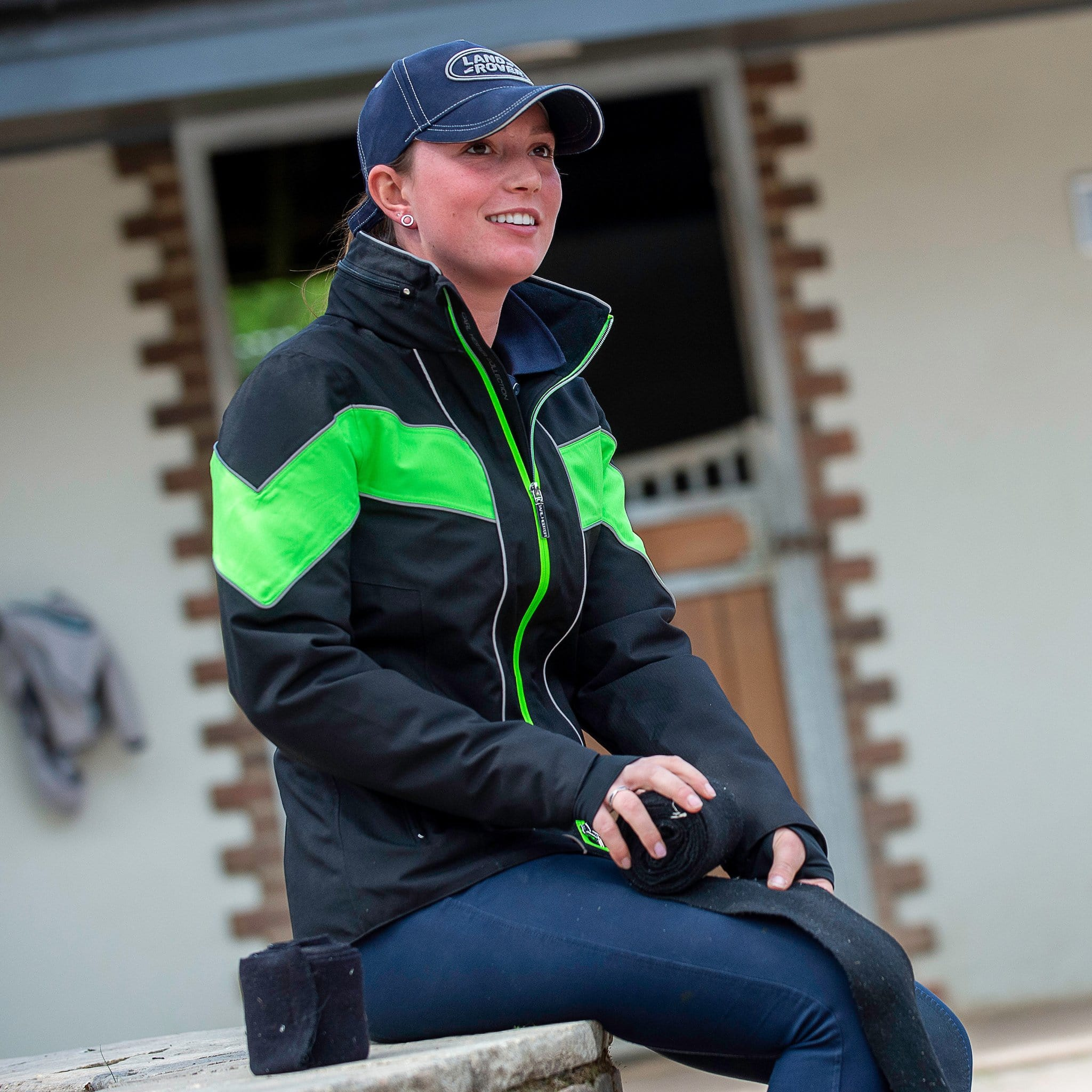 Equisafety Carl Hester Giorgione Waterproof Jacket CHC1 Green On Female Model Rolling Bandage