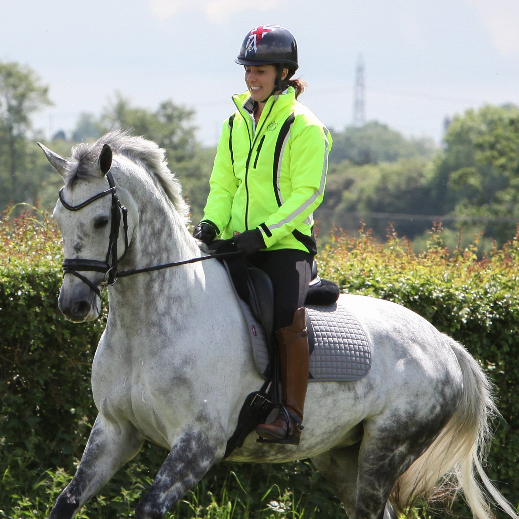 Equisafety Charlotte Dujardin Cadence High Visibility Jacket CY6 Yellow Rider Cantering