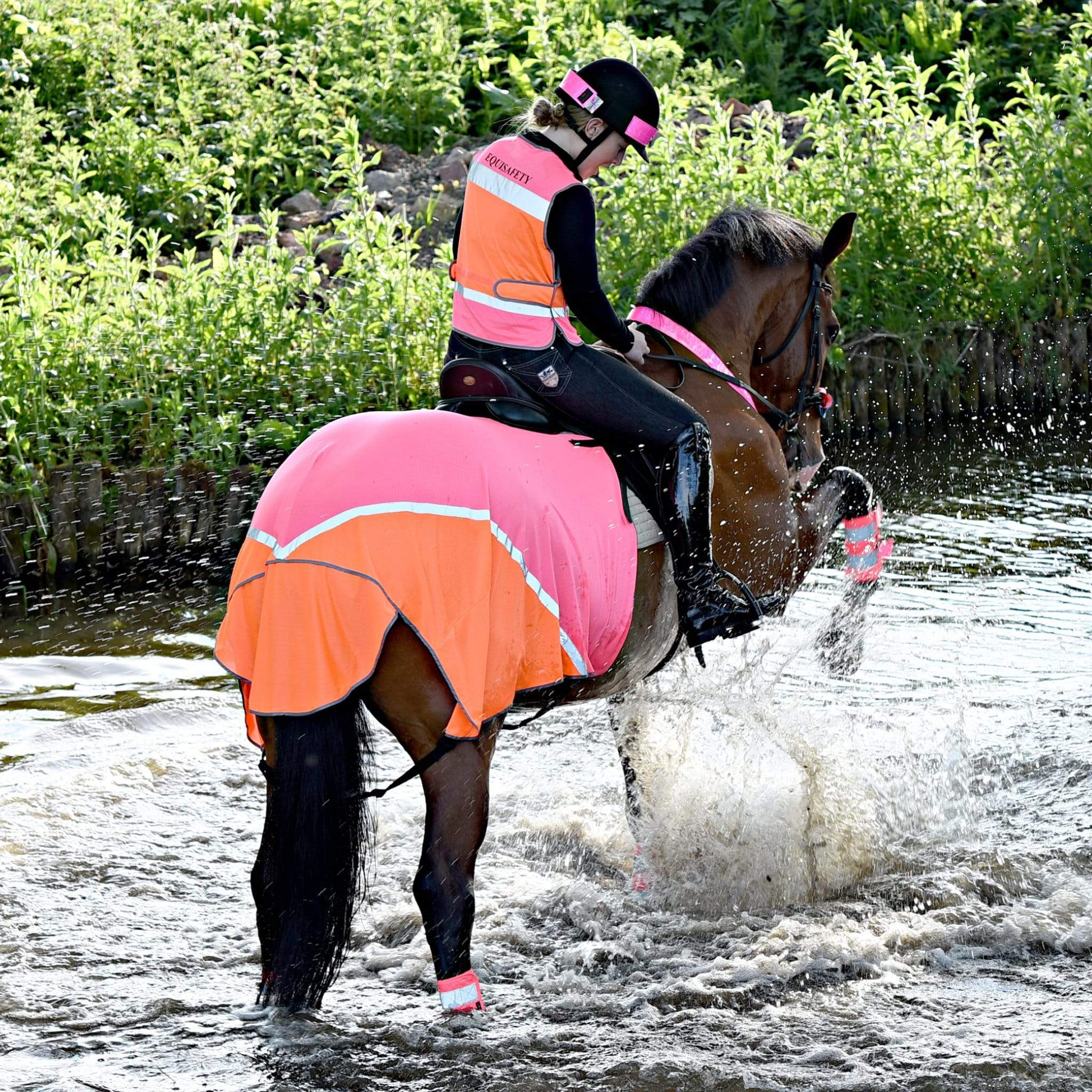 Equisafety Charlotte Dujardin Multi-Coloured Hi-Viz Exercise Sheet MR Pink and Orange Horse Splashing