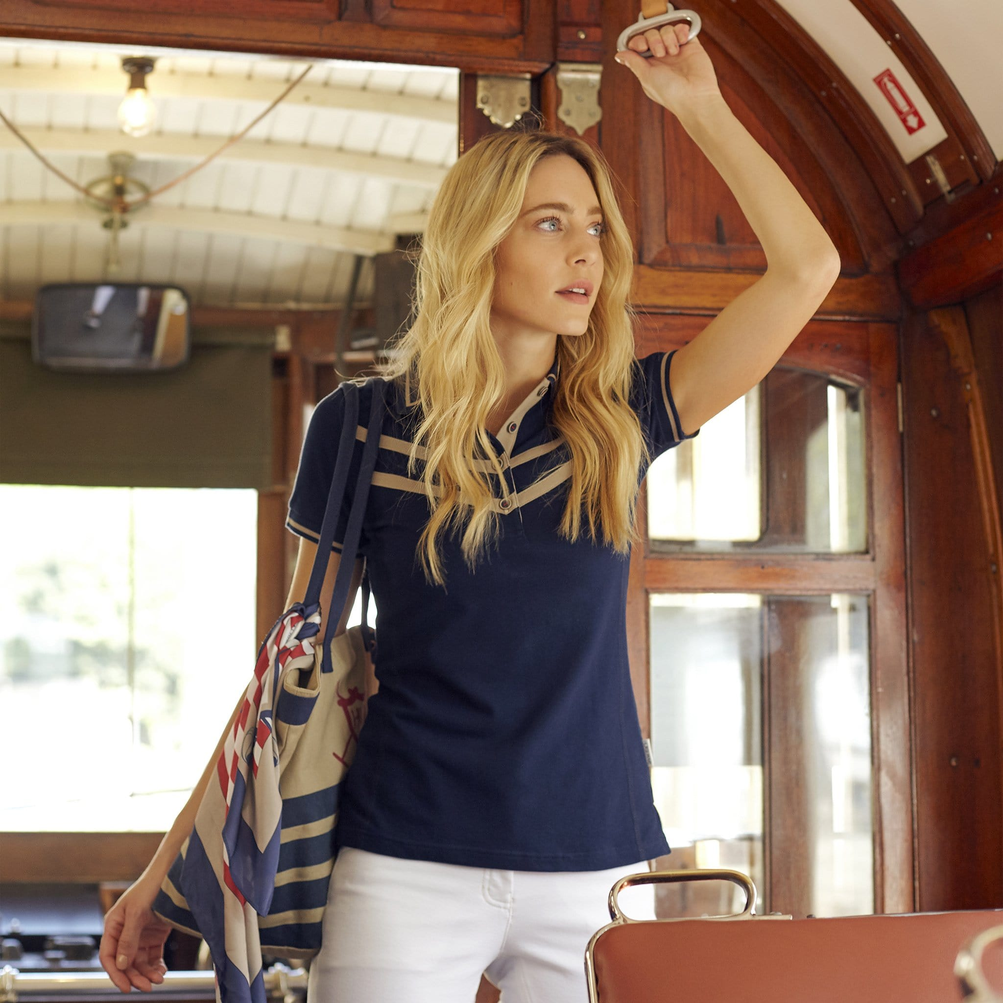 Horseware Clara Polo Shirt CJNBLP Navy On Model On Boat With Bag