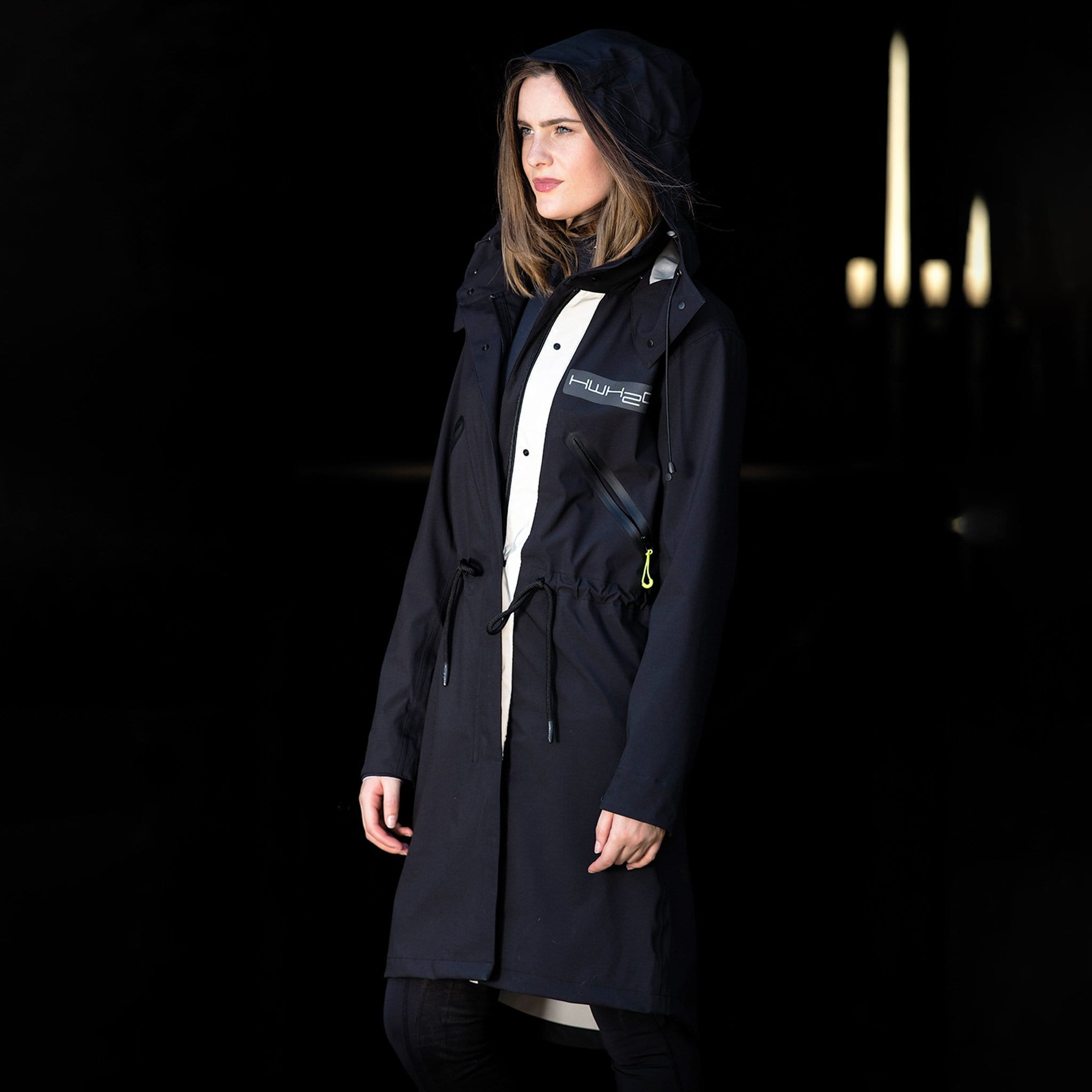 Horseware HWH2O Unisex Waterproof Parka CAHPHP Black On Model In Barn With Hood Up Side View