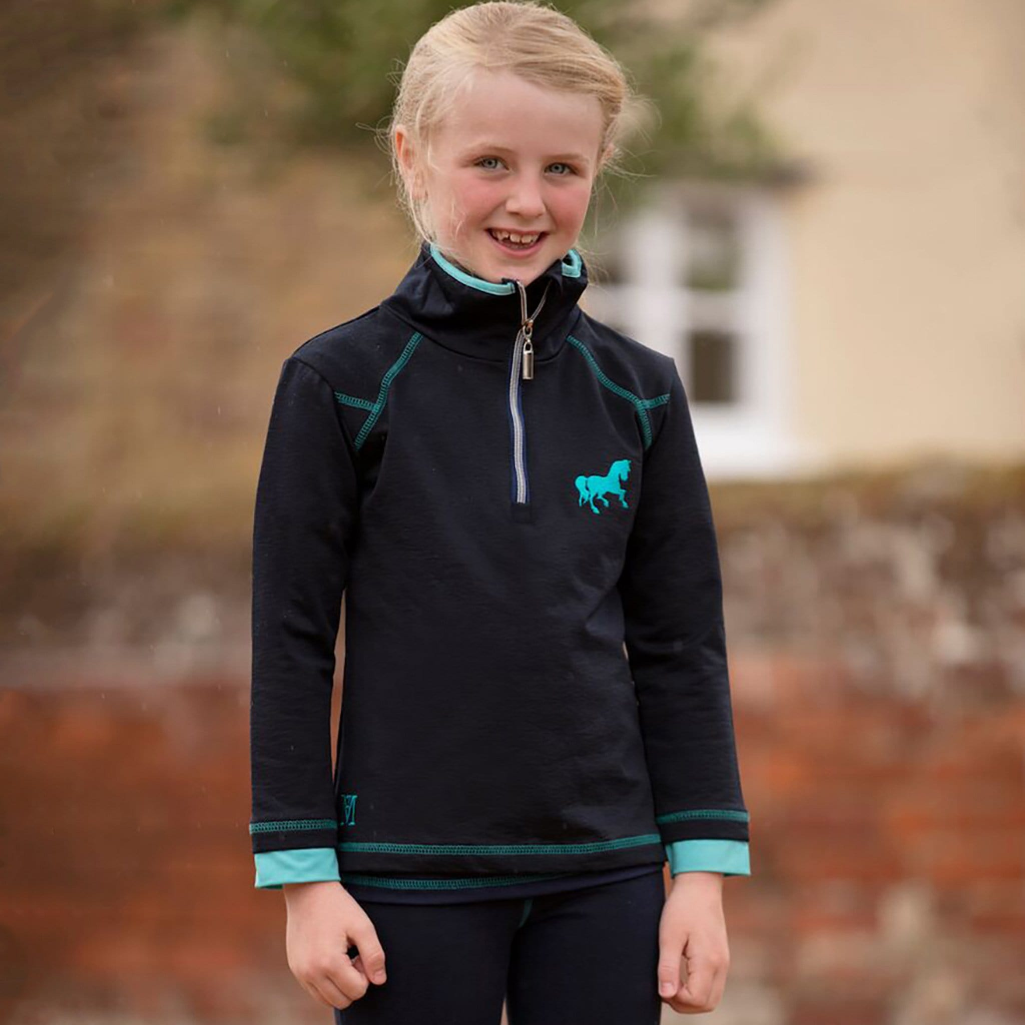 Mark Todd Silicone Horse Children's Training Top TOD603474 Navy and Aqua On Child Front