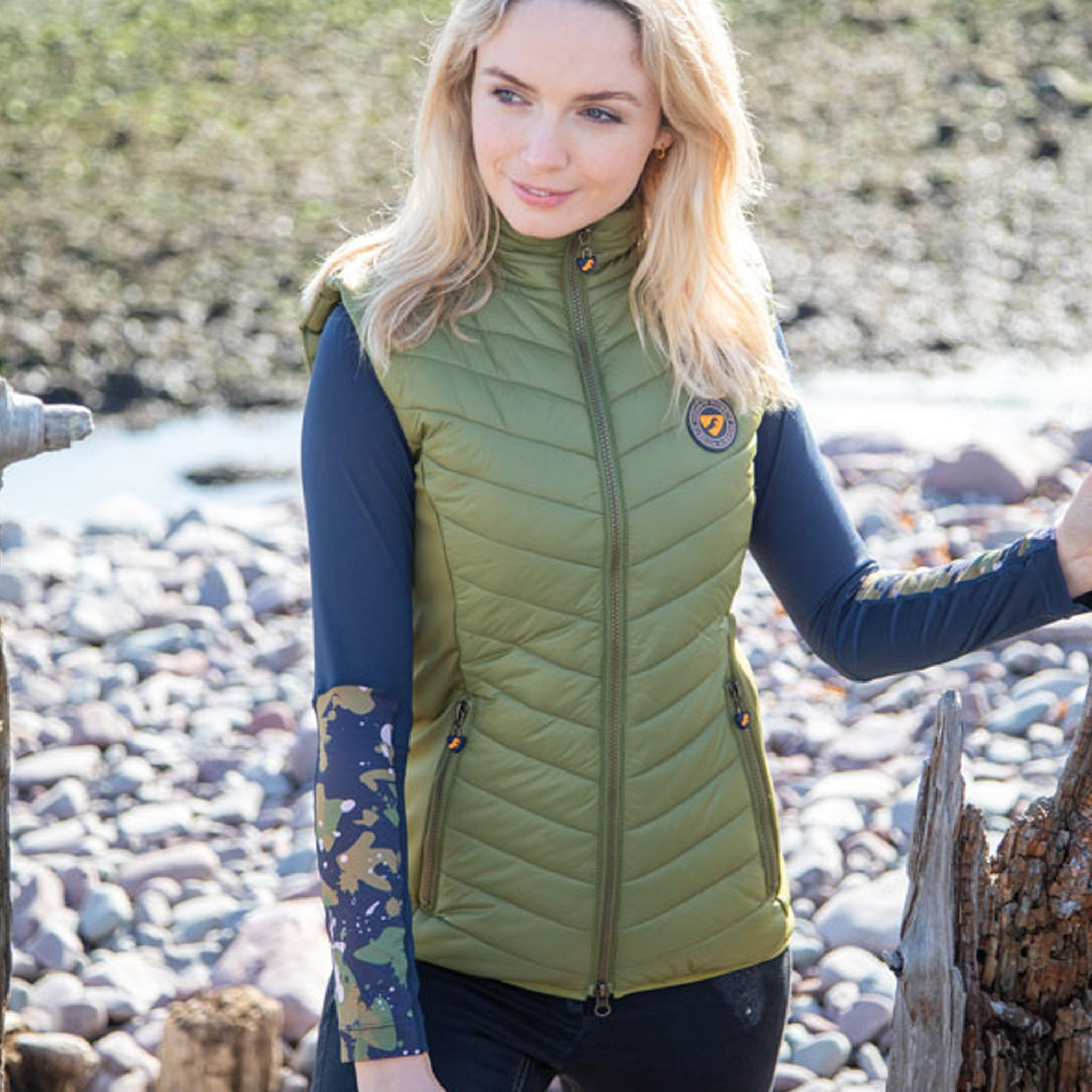 Shires Aubrion Cannon Insulated Gilet 8152 Olive Green On Model On Rocks