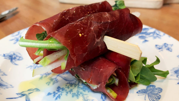 We can't say enough about this Bresaola rolled with pair, gorgonzola, and arugula.