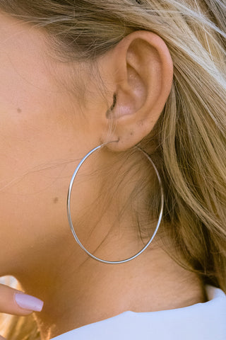 Beyond Reason Silver Hoop Earrings