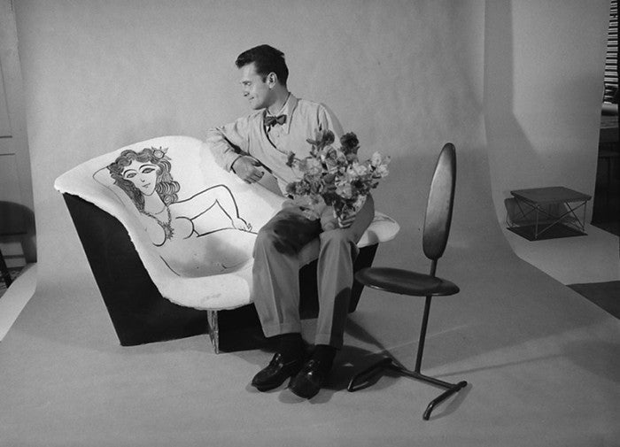 Charles Eames with a chair he and Ray designed and decorated, California, 1950.