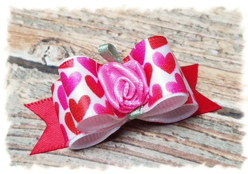 red hearts dog bow with pink satin flower