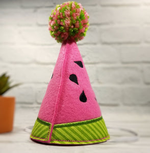 Back of watermelon pet party hat with multi-color pompom