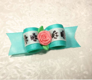 "5/8"" Dog Bow - Aqua Satin with White/Silver Paws and Pink Ribbon Flower"