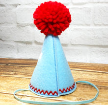Load image into Gallery viewer, Back of light blue party hat with red pompom