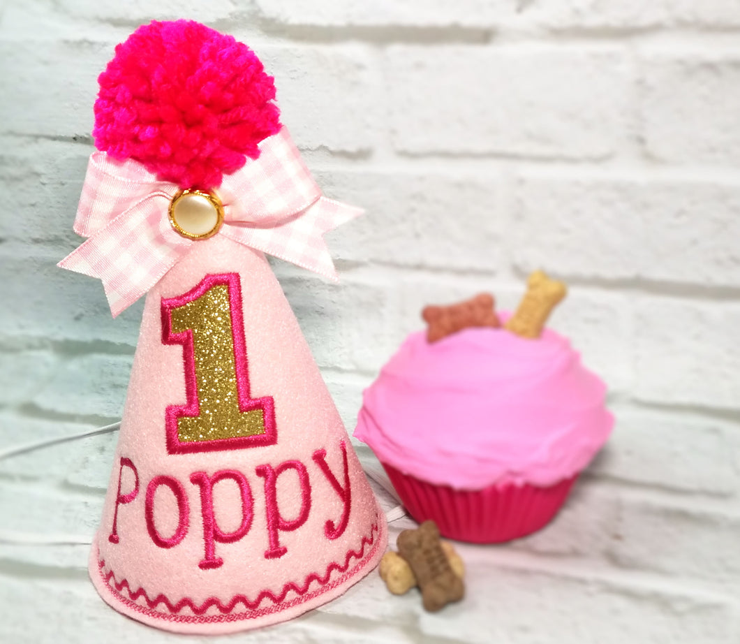 Light pink pet party hat with gold birthday number and gingham ribbon