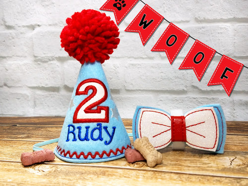Light blue pet party hat with stars and bow tie with red pompom