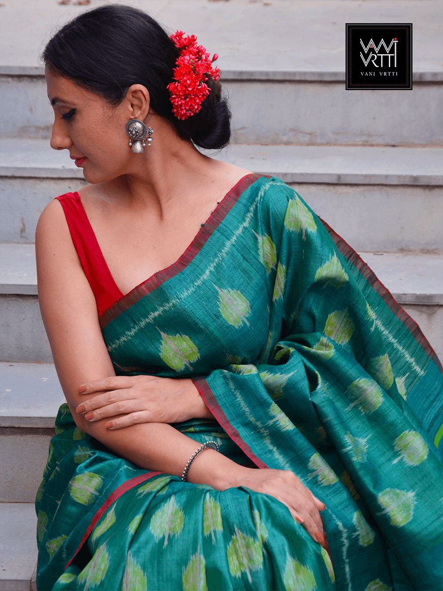 a women in peepal design handspun tussar silk saree