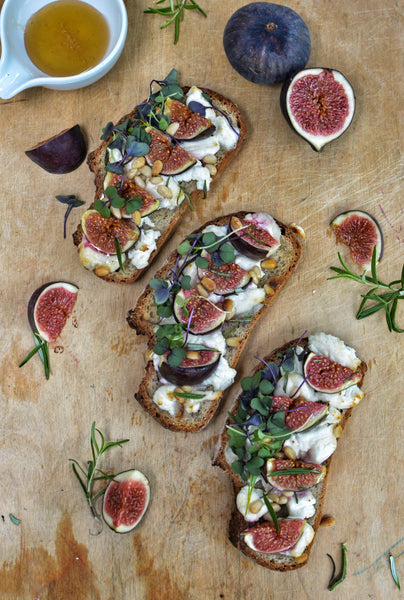 Gluten free tartines of figs, goat cheese and rosemary