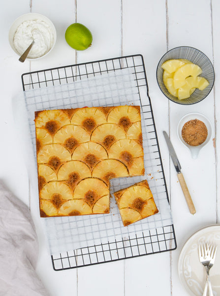 Upside-down pineapple cake with lime-coconut whipped cream