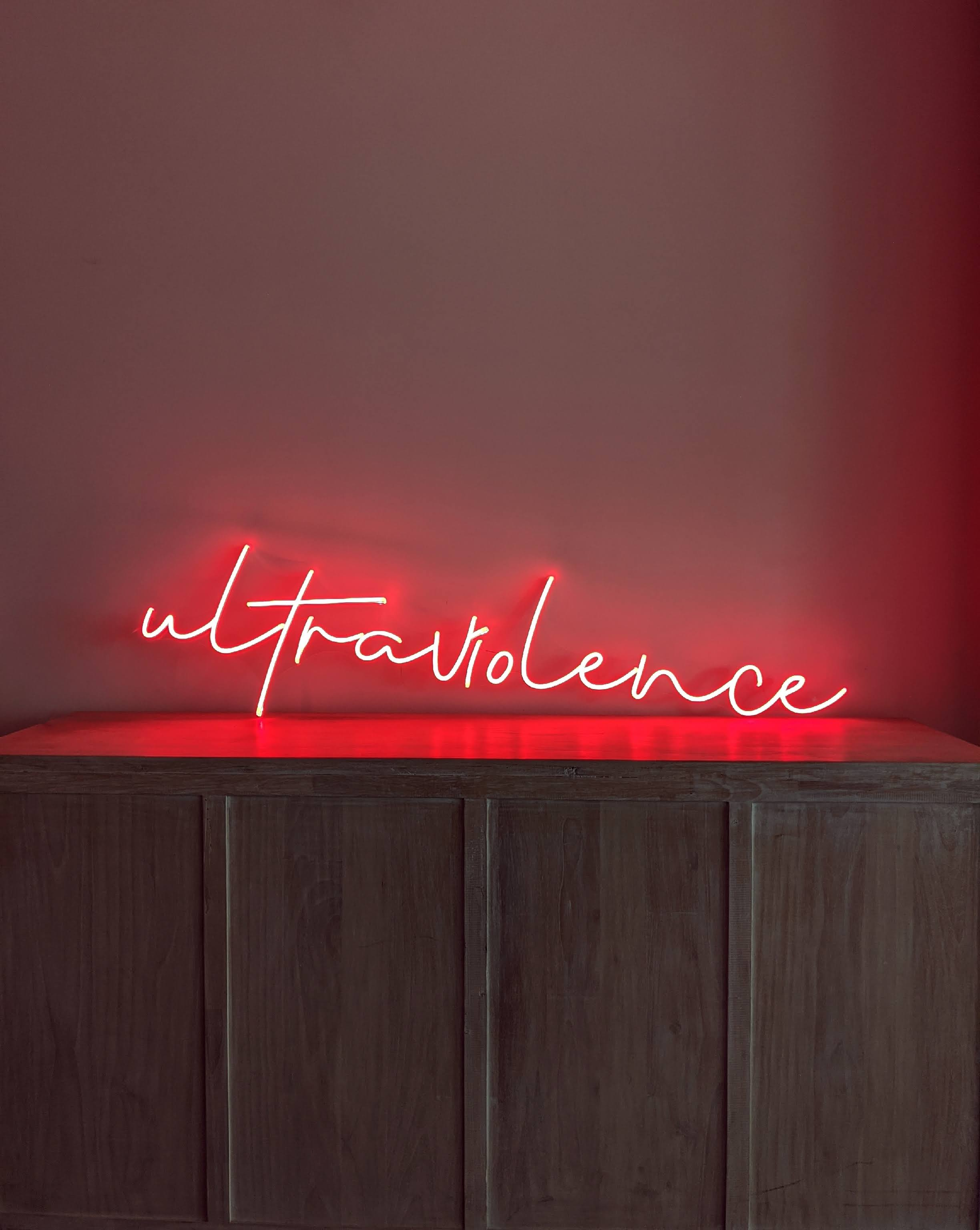 Neon Sign in Crimson Red, Light Up Text Signs for your bedroom or living room. This sign creates ambient lighting for a calm atmosphere at home