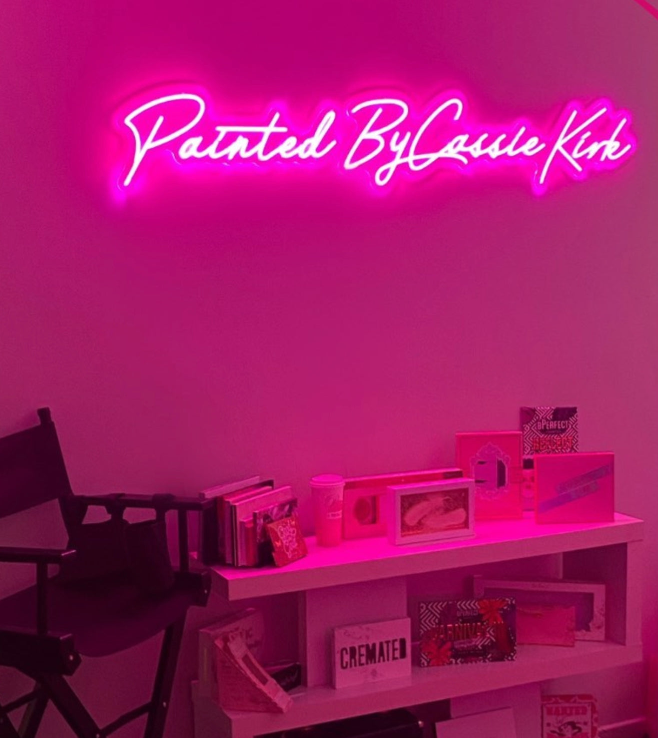 make up studio neon sign created for our client's business. Painted by cassiekirk neon light was made in vivid pink for her home make up studio.                                       she has used it to copyright all her images of her work as a backdrop lighting.