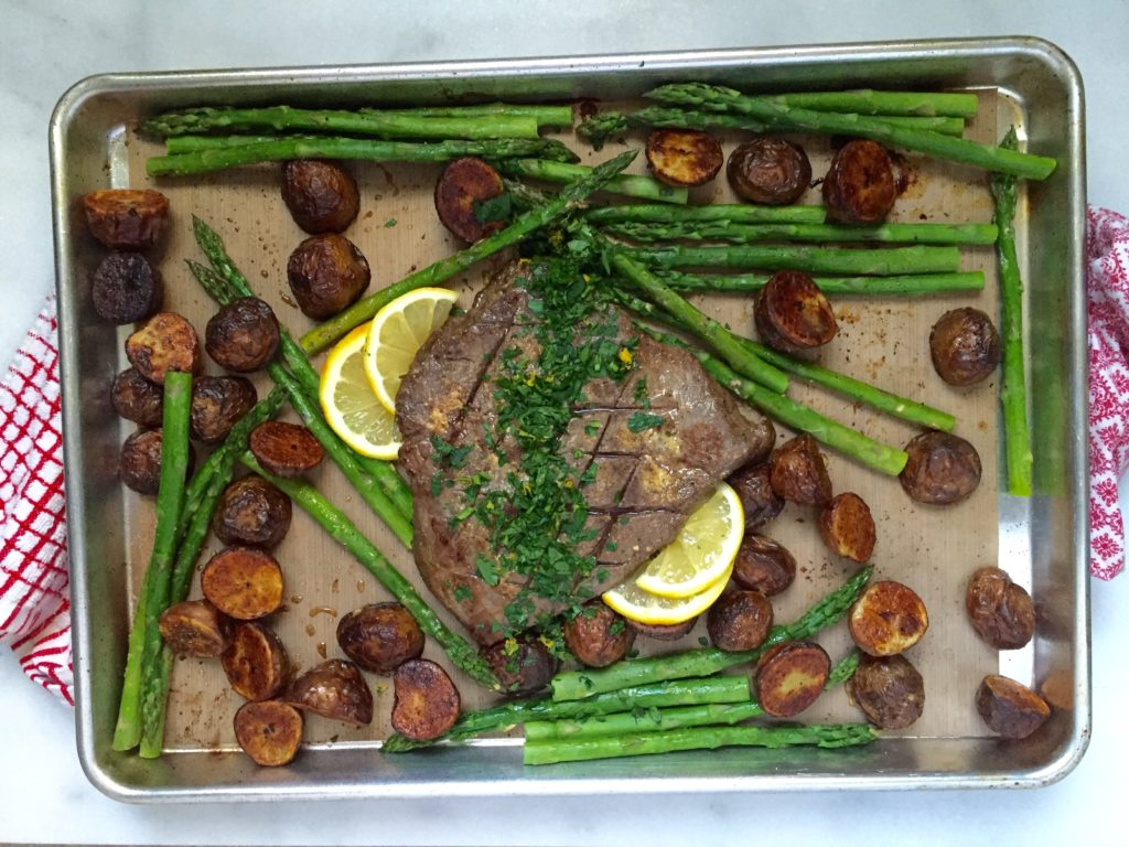One-Pan London Broil dinner featuring steak, potatoes and asparagus