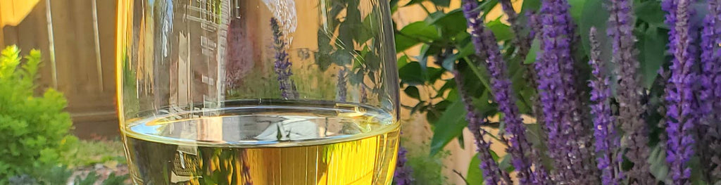 glass of white wine with lavendar flowers