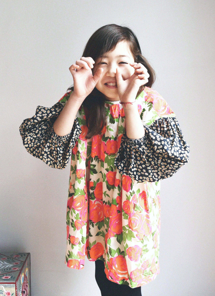 lulaland Fall No.15 Mirage collection. Girl wearing a flower dress. Organic girl's clothes