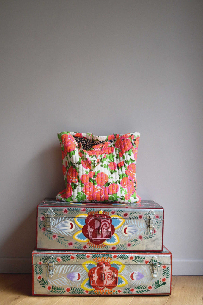 lulaland Fall No.15 Mirage collection. Quilted bag with flowers over a vintage trunk