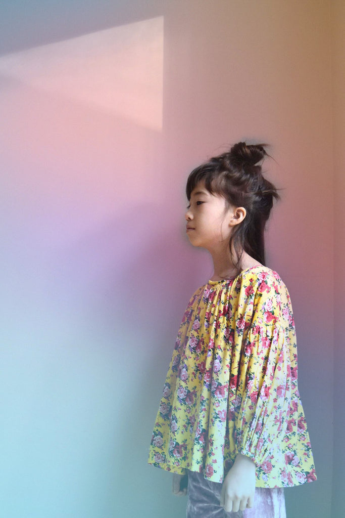 lulaland Fall No.15 Mirage collection. Girl wearing a flower yellow blouse and velvet purple pants. Organic girl's clothes