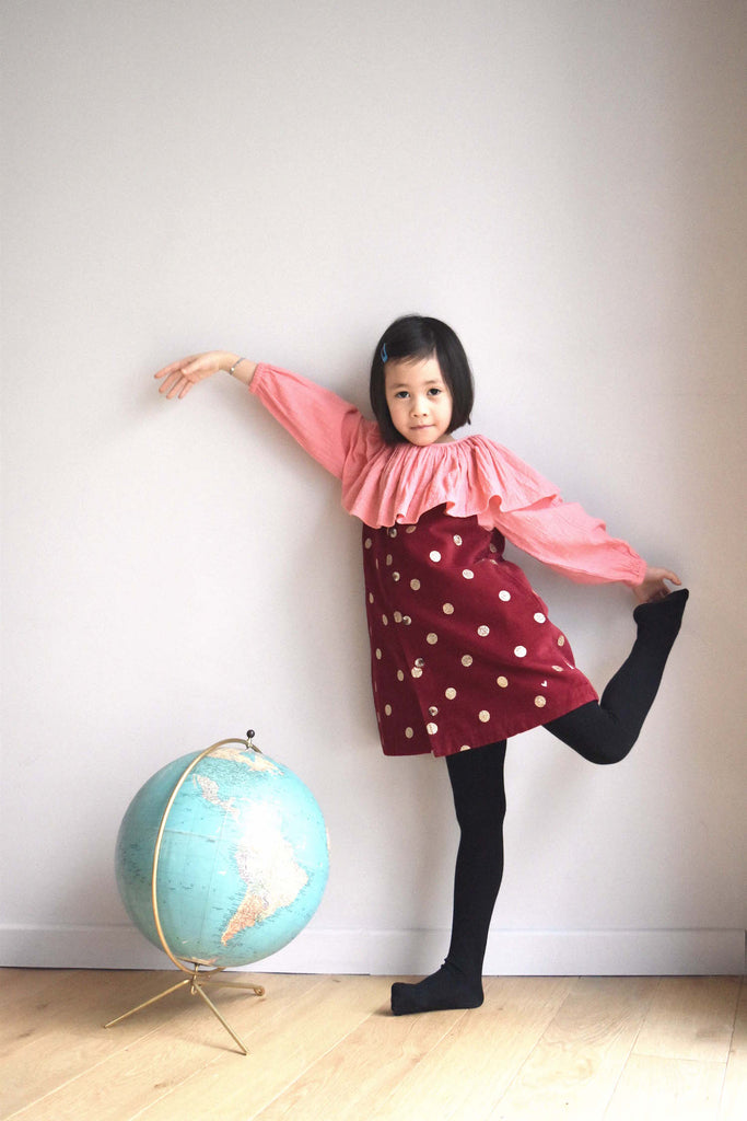 lulaland Fall No.15 Mirage collection. Girl wearing a pink blouse with collar and a red jumper with polka dots. Organic girl's clothes