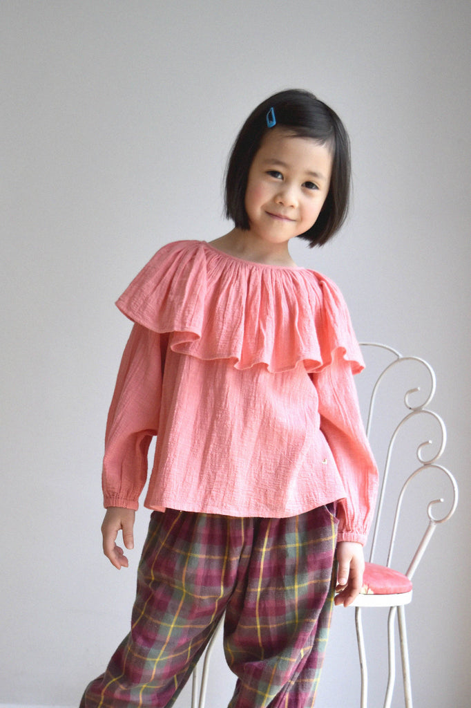 lulaland Fall No.15 Mirage collection. Girl wearing a pink blouse with collar and plaid pants. Organic girl's clothes