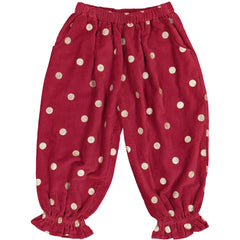 Girls clothes. Bubble pants in red corduroy with gold printed polka dots