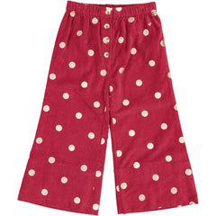 Children's clothing. Red corduroy pants with printed gold polka dots