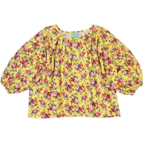 Girl's clothes. girl blouse in flower printed yellow fabric