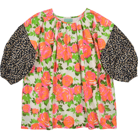 Girl's clothes. Girl dress with pink flowers print and bubble black liberty print sleeves