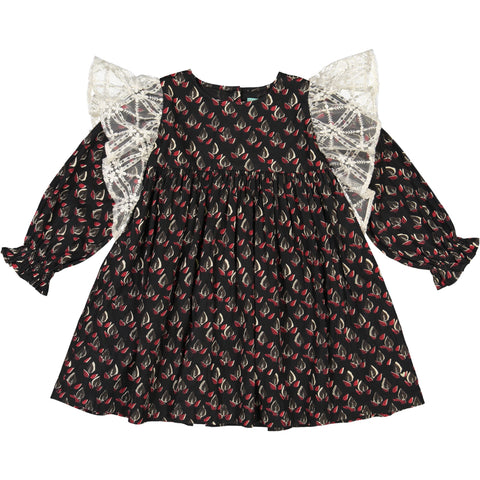 Girls clothes. Black party dress with printed feathers flowers and lace ruffles along the sleeves