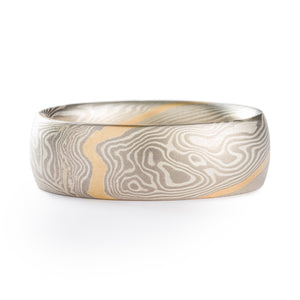 Mokume Gane style ring made by arn krebs, twist pattern with a gold strip running diagonally across the ring, the rest of the ring is alternating layers of silver and palladium