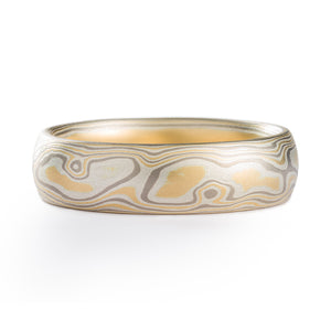 Mokume gane ring made by arn krebs, patterning is made up of alternating layers of silver and palladium, the pattern resembles the grain of a piece of wood