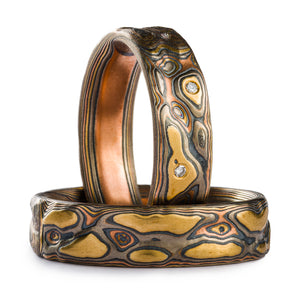 Mokume Gane ring set, Guri Bori patterning that resembles a topographic map, created by carving into the surface of the ring. The metals in the ring are yellow gold, red gold, palladium and silver