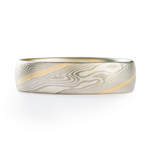 Ring band made by arn krebs, mokume gane twist ring with a yellow gold stratum layer running diagonally across the band in multiple spots, made of palladium and sterling silver