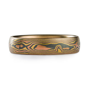 Mokume Gane woodgrain pattern by arn krebs, metals used are red gold and yellow gold with alternating layers of oxidized silver