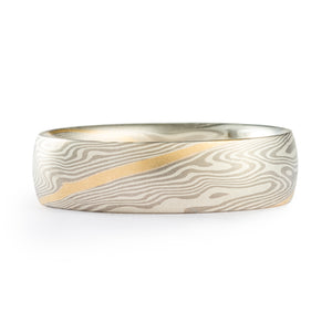 Mokume Gane unisex ring or wedding band, made by Arn Krebs, twist pattern, metals used are palladium and silver, with a gold stratum layer (stripe running across the ring following the pattern)
