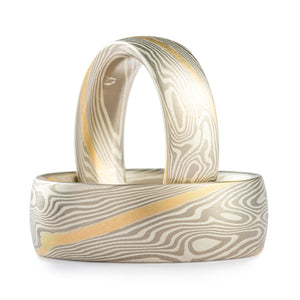 Mokume Gane unisex rings or wedding band set, made by Arn Krebs, twist pattern, metals used are palladium and silver, each with a gold stratum layer (stripe running across the rings following the pattern)