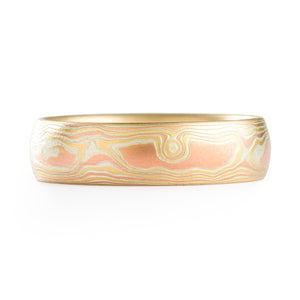 Mokume Gane ring or wedding band made by arn krebs, this ring is made in our woodgrain pattern and fire palette. The fire palette is red gold yellow gold and silver, and this ring has a non oxidized and etched finish with a low dome profile.