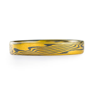 Mokume gane patterned ring, twist, arn krebs, made with yellow gold and oxidized silver, thin band with a flat profile
