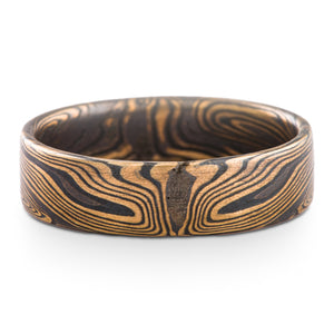 mokume gane ring by arn krebs in spark palette and echo pattern, flat profile, yellow gold and sterling silver