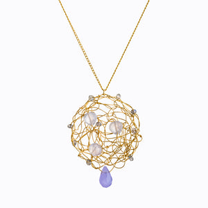 Iolite gemstone pendant, stones are interwoven with gold filled wire spun into a flat disk, also a larger iolite drop hanging from the very bottom center of the pendant