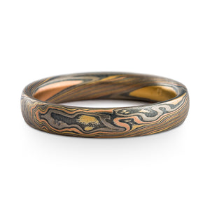 Mokume Gane ring or wedding band made by arn krebs, firestorm palette and twist pattern, etched and oxidized finish, red gold yellow gold palladium and sterling silver